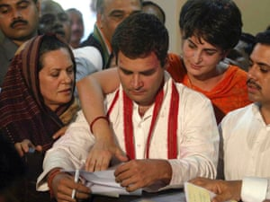 Congress candidate Rahul Gandhi, center, is flanked by his mother and Congress Party President Sonia Gandhi, left, and sister Priyanka Vadra, right, as brother-in-law Robert Vadra stands beside as he files his candidacy papers for Amethi constituency in Sultanpur, in the northern Indian state of Uttar Pradesh.