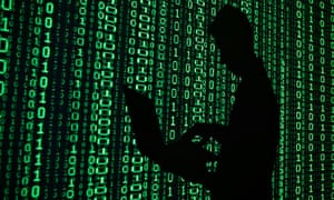 Man in front of binary code