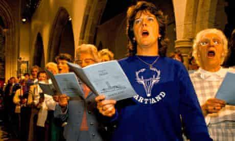 Church congregation sing hymns