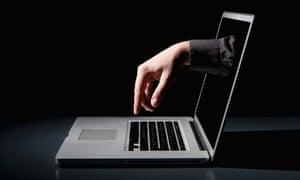 hand reaching through laptop screen