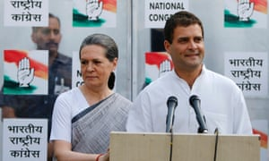 Congress party vice-president Rahul Gandhi speaks to the media as his mother and chief of Congress Sonia Gandhi  stands next to him during a news conference in New Delhi,