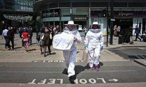 Swarm of honeybees descends on Topshop, central London