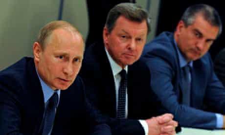 Russia's Vladimir Putin with his envoy to Crimea Oleg Belaventsev and Crimea's PM Sergei Aksyonov