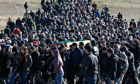 Crimean Tatars gather at a cemetery for the funeral of Reshat Ametov