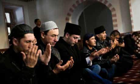 Tatar men pray in the Kebir-Dzhami mosque in Simferopol, Crimea