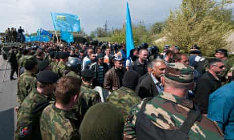 Crimean Tatars protest at a blocked road outside Armyansk
