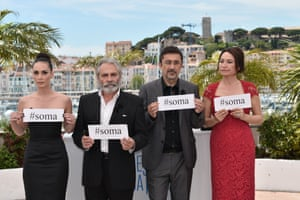 """Turkish actress Demet Akbag, director Nuri Bilge Ceylan, actor Haluk Bilginer and actress Melisa Sozen hold signs reading """"Soma"""" to pay their respects to the 284 Turkish miners who died following an explosion."""