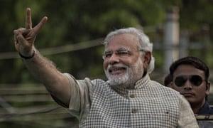 Narendra Modi makes a victory sign