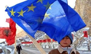 An Ethnic Kosovo Albanian boy carries a