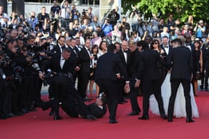 Security remove the man who ran onto the red carpet.
