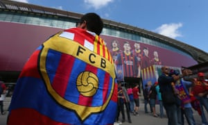 Barcelona fans arrive for the game.