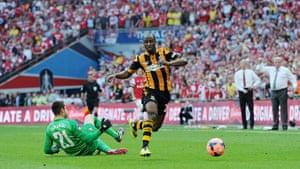 fa cup final : Sone Aluko skips past Arsenal goalkeeper Lukasz Fabiansk