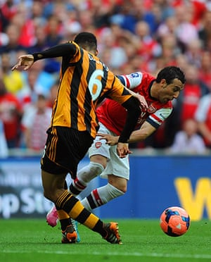 the cup final: Santi Cazorla is brought down by Curtis Davies in the area
