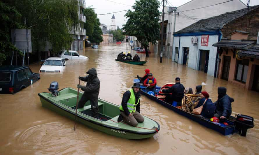 People evacuate in boats from Obrenovac, south-west of Belgrade, on Saturday.