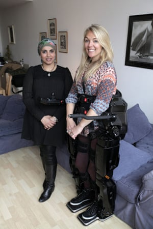 Dr Saleyha Ahsan and Sophie Morgan with the Rexbionic exoskeleton