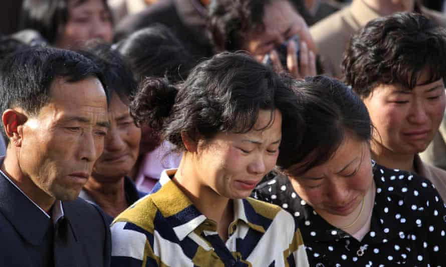 North Koreans grieve during a gathering in Pyongyang where senior officials apologised for a building collapse.