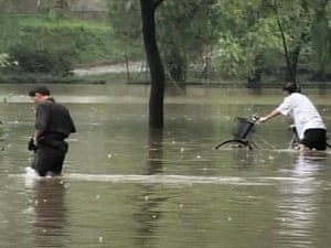 North Koreans in a flooded street in Pyongyang in 2007. Severe floods were projected to hamper the country's ability to feed itself for at least a year, according to aid groups.