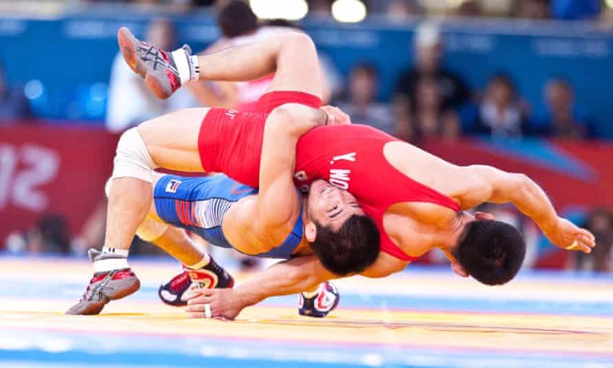 Yun Won-chol of North Korea wrestles with South Korea's Choi Gyujin.