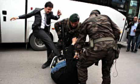 Yusuf Yerkel kicks a protester in the town of Soma, Turkey