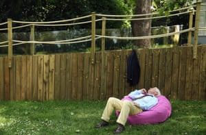 A man sleeps in the sun at the 2014 Chelsea Flower Show at Royal Hospital Chelsea on May 19, 2014 in London, England.