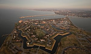 Aerial photos of Hampton Roads with Fort Monroe in the foreground. The smaller island in some photos is Fort Wool.