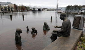 The Kunta Kinte-Alex Haley Memorial sits in flood waters in downtown Annapolis, Md., Tuesday, Oct. 30, 2012, after the superstorm and the remnants of Hurricane Sandy passed through Annapolis.