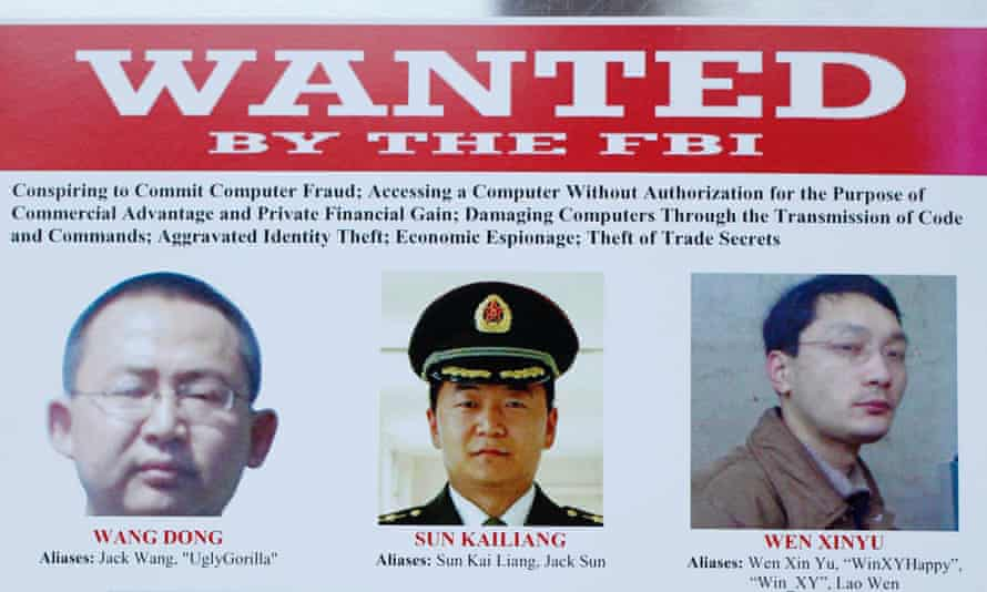 Three of the five officials on an FBI 'Wanted' poster.
