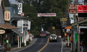 Cars pass under a sign thanking firefighters that hangs over highway 120 on August 27, 2013 in Groveland, California. As the Rim Fire continues to burn in and around Yosemite National Park, local businesses along highway 120 are taking a financial hit as tourists are diverted to other entrances to the park due to the closure of highway 120.
