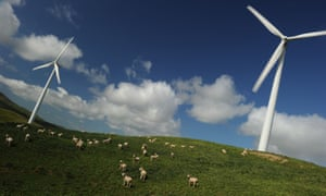 Sheep graze under wind turbines at Te Apiti wind farm in Manawatu Gorge, New Zealand