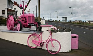 A tractor and bicycle at Ballintoy, painted pink to celebrate the Giro d'Italia.