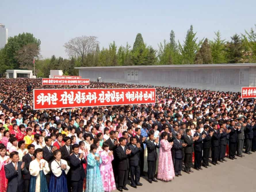 A picture release by KCNA on 02 May 2014 shows North Korean workers attend a rally in Pyongyang, to celebrate the May Day holiday.