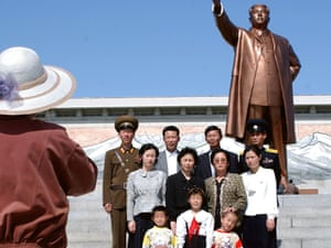 A North Korean family have their photo taken in front of the statue of late President Kim Il-sung on May Day in Pyongyang.