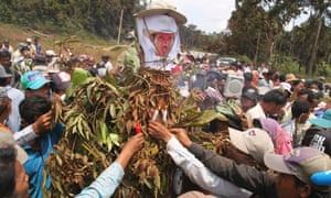 People light candles at the killing site of Cambodian anti-logging activist Chut Wutty in Koh Kong province