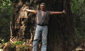 "Amazon rainforest activist Jose Claudio Ribeiro da Silva poses in front of a tree at Praia Alta Piranheira settlement in this October 9, 2010 file photo. Silva, known as ""Ze Claudio,"" and his wife Maria, defenders of the Amazon rainforest who constantly reported illegal loggers and ranchers, were killed in an ambush in May, 2011, in Nova Ipixuna."