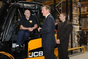 Prime Minister David Cameron and Conservative Prospective Parliamentary Candidate for Newcastle-under-Lyme Tony Cox (right) meet perpetual infantry Bill Martin during a tour of the JCB World Logistics site in Newcastle-under-Lyme as part of the Conservative Party's European and Local Election campaign trail.