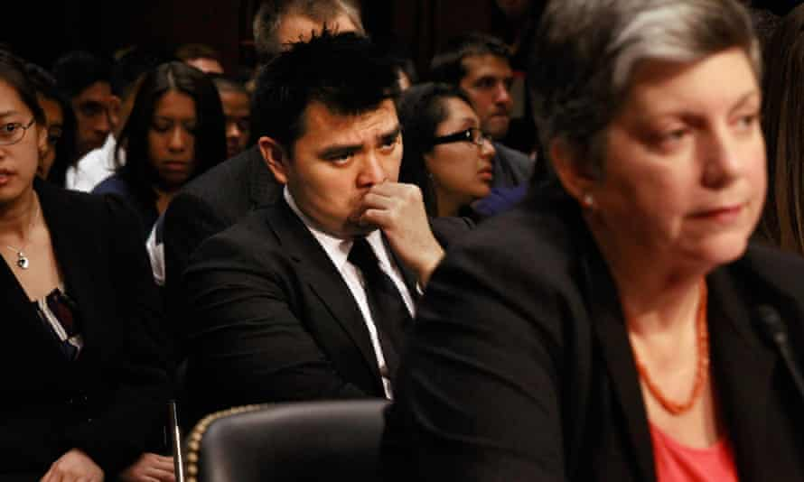 Jose Antonio Vargas sits behind Janet Napolitano as she testifies before the Senate in June 2011.