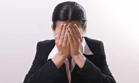 Business woman crying head in hands
