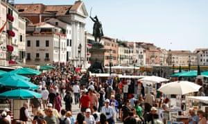 Tourists swarm near St Mark's Square in Venice.