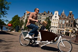 Take the kids up front in a cargo-tricycle, called a bakfiets.