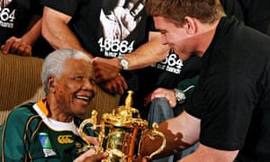 Springboks captain John Smit hands the rugby World Cup trophy to Nelson Mandela