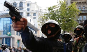 A pro-Russian activist aims a pistol at supporters of the Kiev government during clashes in the streets of Odessa May 2, 2014.