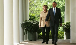 U.S. President Barack Obama (R) and German Chancellor Angela Merkel come out from the Oval Office for a joint news conference in the Rose Garden at the White House May 2, 2014 in Washington, DC.