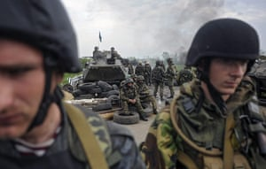 20 Photos: Soldiers stand near a checkpoint seized by them near Slavyansk in Ukraine