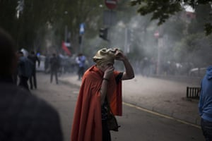20 Photos: A pro-Russian activist after police fired teargas in Donetsk
