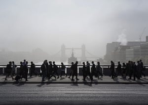 20 Photos: Commuters cross London Bridge during the strike by underground train staff