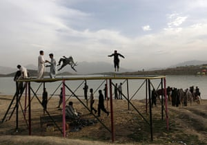 20 Photos: Afghans play on a trampoline along Qargha Lake, on the outskirts of Kabul