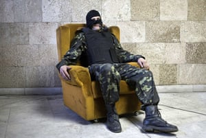 20 Photos: A pro-Russia protester poses inside a government building in Donetsk