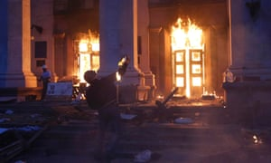 A protester throws a petrol bomb at the trade union building in Odessa.