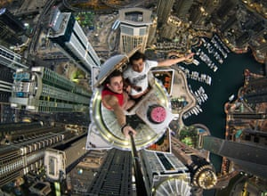A RUSSIAN daredevil has captured a vertigo-inducing selfie - while standing on top of a Dubai skyscraper. Nineteen-year-old Alexander Remnev scaled the Princess Tower - the worlds tallest residential building at 1,350ft - before getting his camera out to take these stomach-churning pictures. Alexander, who was on holiday in Dubai with friends, says they climbed a number of the citys towering skyline during the course of their stay.