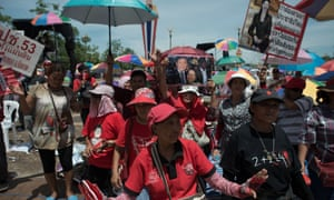 Pro-government ''Red shirts'' at a rallies on the outskirts of Bangkok after martial law was declared.